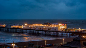 View of Brighton pier floodlit at night. And the sea stock photos