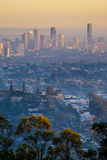 View of Brisbane City and suburbs from Mt Gravatt at dawn. Zoomed in view of Brisbane City buildings at dawn with the inner suburbs of Brisbane in the foreground Stock Images