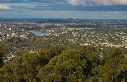 View of Brisbane Queensland Australia from lookout on top of Mt Coot-tha with trees in the foreground and a Kookaburra bird royalty free stock photos