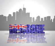 View of Brisbane. Word Brisbane with national flag of australia near skyline silhouette Royalty Free Stock Photos
