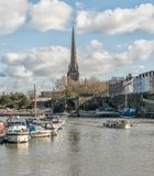 A view of Bristol Docks with the Church of St Mary Redcliffe stock images