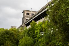 View of the Britannia bridge from below. Looking up through trees at the Britannia Bridge, over the menai Strait between Gwynedd and Anglesey. North Wales Royalty Free Stock Image