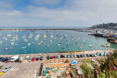 View of Brixham harbour and marina Devon England UK during the heatwave of Summer 2013. View of Brixham harbour and marina Devon England UK with boats on a calm Royalty Free Stock Image