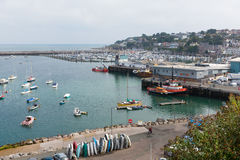 View of Brixham harbour and marina Devon England UK during the heatwave of Summer 2013. View of Brixham harbour and marina Devon England UK with boats on a calm Royalty Free Stock Photo