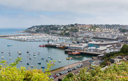 View of Brixham harbour and marina Devon England UK during the heatwave of Summer 2013. View of Brixham harbour and marina Devon England UK with boats on a calm Stock Photo