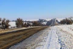 Broken cracked asphalt road on winter Royalty Free Stock Photos