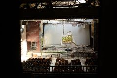 The view of broken screen from window in the abandoned theatre in Taiwan. royalty free stock images