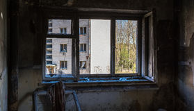 View through the broken window in abandoned house Royalty Free Stock Photo
