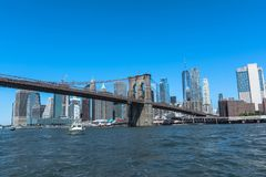 Brooklyn Bridge over the East River, Manhattan, NYC. View of the Brooklyn Bridge from the East River, Manhattan, NYC stock image