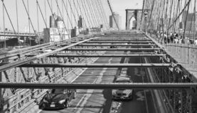 View on Brooklyn bridge and Hudson river with cars running and modern skyline in background in Manhattan, New York royalty free stock photos