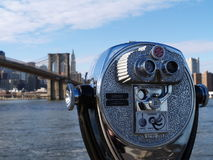 View of Brooklyn Bridge, New York. View of Brooklyn bridge in New York, Manhatten with a coin operated telescope viewer for tourists Royalty Free Stock Photography