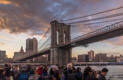 View of Brooklyn Bridge. New York, NY USA - June 4, 2018. People enjoy sunset view of Brooklyn Bridge from cruise ship on East River, NYC Royalty Free Stock Photo