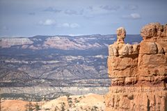 Bryce Canyon 09. View of Bryce Canyon, showing amazingly colorful rock formations with lovely light and shadow. Horizon and clouds in the distance Stock Photo