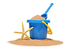 A view of a bucket, scoop and a yellow starfish Royalty Free Stock Image