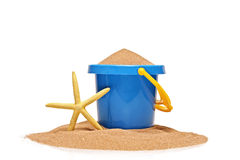 A view of a bucket and a yellow starfish. Isolated on white background Stock Photography