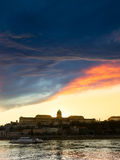 View of buda castle in budapest from danube river. At sunset, Hungary Royalty Free Stock Photo