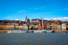 View of the Buda from Pest. The Fisherman`s Bastion, the Matthias Church and Protestant church. Budapest, Hungary royalty free stock photography
