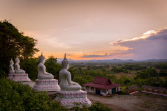 View Buddha statue. And mountain background Sunset Royalty Free Stock Images
