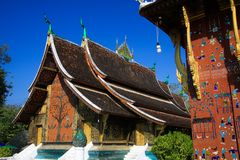 View on buddhist temple against blue sky - Wat Xieng Thong, Luang Prabang stock images