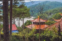 View of Buddhist temple and lake. In Vietnam Royalty Free Stock Photo