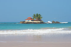 View on the Buddhist templeon an island in the Indian ocean. Hikkaduwa, Sri Lanka Royalty Free Stock Photography