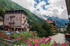 View of building, creek, flowers and the Mont Blanc in Chamonix royalty free stock image