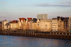 View of building facades of Dusseldorf. Embankment at the sunset Royalty Free Stock Photo