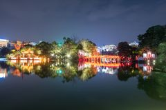 View of building huc red bridge with shrine in Hoan Kiem lake Royalty Free Stock Image