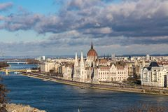 View of the building of the Hungarian Parliament illuminated by the rays of the sun in Budapest, Hungary royalty free stock photography