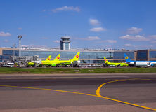 View of the building of the passenger terminal of Domodedovo Airport and planes facing it Royalty Free Stock Images