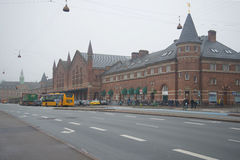View of the building of the railway station foggy November day. Copenhagen Stock Photos
