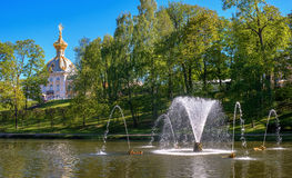 View of the building Special pantry from the Sand Pond. In the center of the pond there is a fountain. Petergof. Russia. Stock Images
