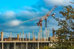 View of the building under construction with tower cranes royalty free stock images