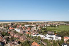 View on the buildings and the beach and greenfield and the northern sea on the island borkum royalty free stock photo