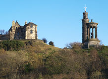 A view of buildings on Calton Hill, Edinburgh, Scotland. These are right to left Observatory House, The Nelson Monument, and the Dugald Stewart Monument Stock Image