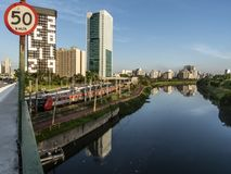 View of buildings, CPTM train, traffic of vehicles and river in Marginal Pinheiros River Avenue stock image