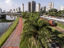 View of buildings, CPTM train, traffic of vehicles and river in Marginal Pinheiros River Avenue stock images