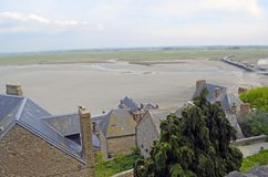 Buidings and roofs in Mont Saint Michele in France, Normandy. View of buildings and roofs of Mont Saint Michele in Normandy, France. View of the ocean and the royalty free stock photo