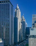 Buildings and skyscrapers over street with buses and cars, in downtown Chicago, USA stock photos