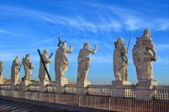 View on the roof of St. Peter`s Cathedral, Rome. View of the buildings and statues of the apostles on the roof of St. Peter`s Basilica, Rome, Italy royalty free stock image