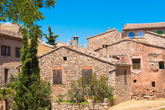 View of the buildings in the village Siurana de Prades, Tarragona, Catalunya, Spain. Isolated on blue background. Stock Photo