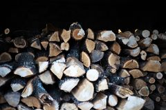 View of a bulk of firewoods in the shed.  stock photography