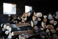 View of a bulk of firewoods in the shed.  stock images