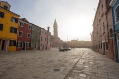 View of Burano island in a foggy day, a small island inside Venice Venezia area, famous for lace making and its colorful houses royalty free stock image