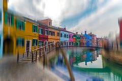 View of island Burano, Italy. View of Burano, Italy, an island with colorful architecture in the Venetian Lagoon. Motion blur filter applied Royalty Free Stock Photo