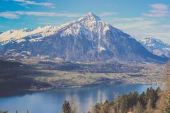 View of Burgfeldstand mountain of Emmental Alps with clear lake Stock Image