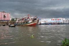View of the Buriganga river at Sadarghat area with some launches Stock Images