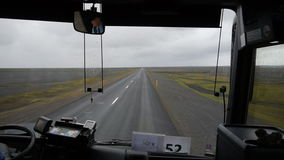 View from the bus. The movement of the bus in the rain on the volcanic desert. Iceland. stock footage