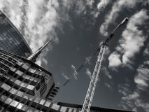View of business district. With crane Stock Images