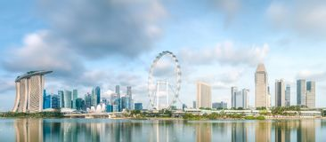 Business district and Marina bay in Singapore. View of business district and Marina bay skyline during sunrise in Singapore royalty free stock image